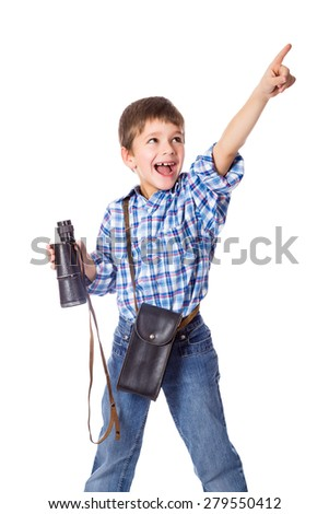 Smiling boy standing with spyglass and pointing up by finger, isolated on white - stock photo