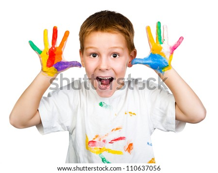 smiling boy with hands in paint  on a white background - stock photo