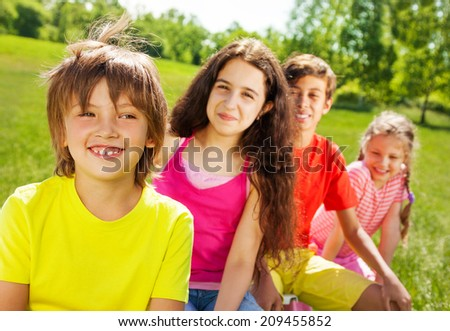 Smiling boy with his friends in summer