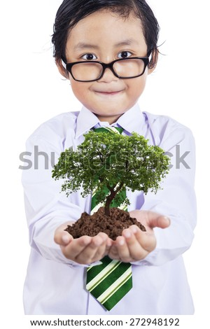 Smiling boy with plant in hands, isolated on white background - stock photo