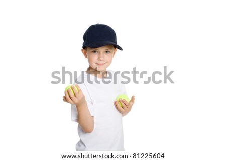 Smiling boy with tennis balls. Isolated on white. - stock photo