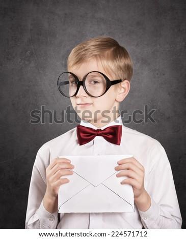 Smiling boy with the white envelope. Retro style portrait - stock photo