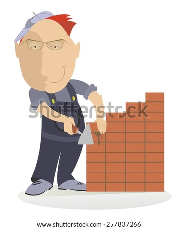 Smiling bricklayer makes the brickwork
