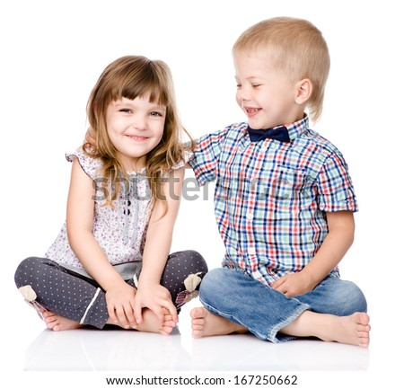 Smiling brother and little sister hugging. isolated on white background - stock photo