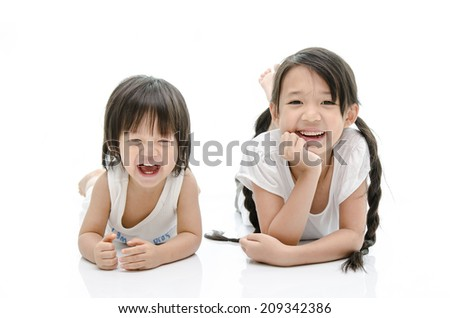 Smiling brother and sister Isolated - stock photo