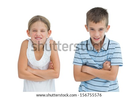 Smiling brother and sister posing together on white background - stock photo