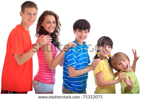 Smiling brothers and sisters standing in a line in order of age with hands on shoulders. - stock photo