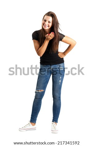 Smiling brunette woman after sending kiss to a camera. Full body length isolated over white. - stock photo