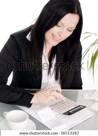 smiling brunette woman sitting with papers and calculator - stock photo