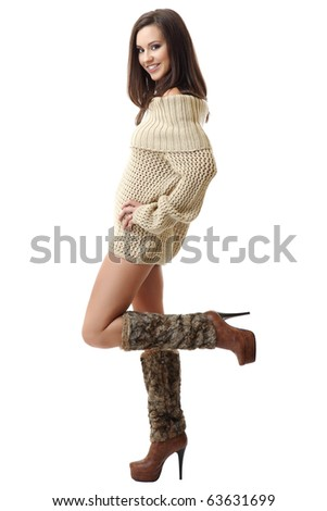 smiling brunette woman wearing braces and posing on white background - stock photo