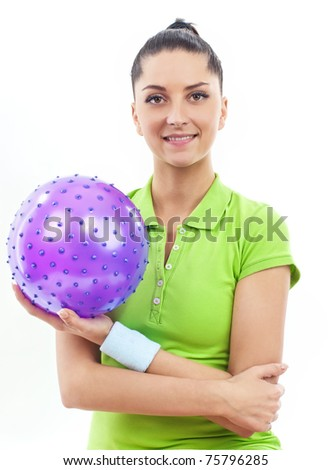 Smiling brunette woman with rubber ball, isolated - stock photo