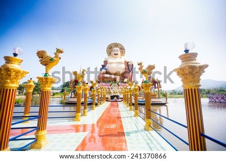 Smiling Buddha of wealth statue on Koh Samui island, Thailand - stock photo