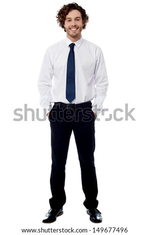 Smiling business executive posing casually - stock photo