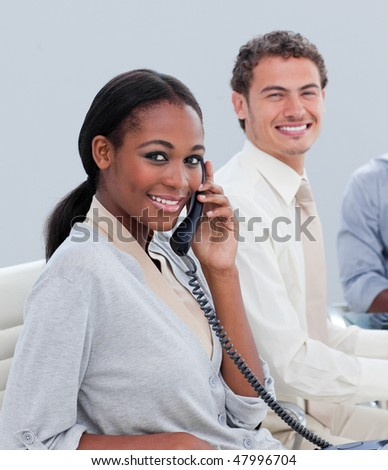 Smiling business group working hard in the office in a company - stock photo