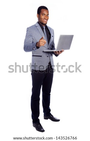 Smiling business man holding a laptop - isolated over a white background