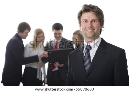 Smiling business man with colleagues in the background - stock photo