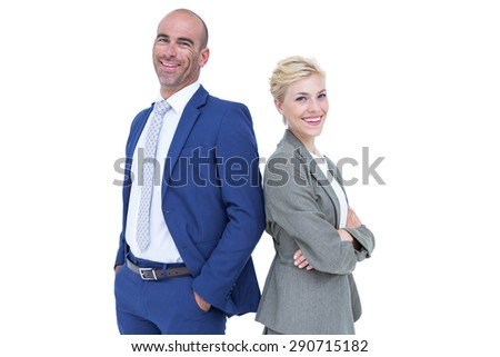 Smiling business people back-to-back with arms crossed - stock photo
