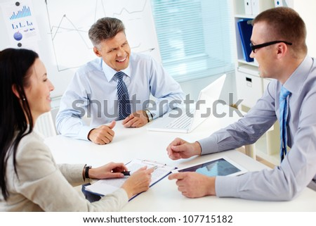 Smiling business people being satisfied with the ideas generated while brainstorming - stock photo