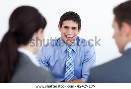 Smiling business people discussing at a job interview in the office - stock photo