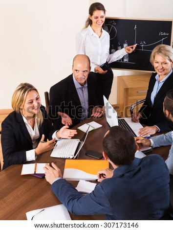 Smiling business people during conference call in office - stock photo