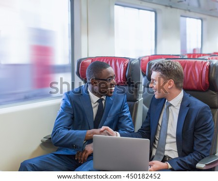 Smiling business people in a train - stock photo