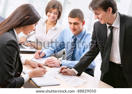 Smiling business people  in board room - Staff meeting - stock photo