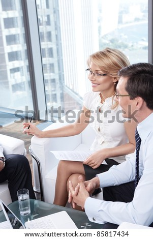 Smiling business people in office - stock photo