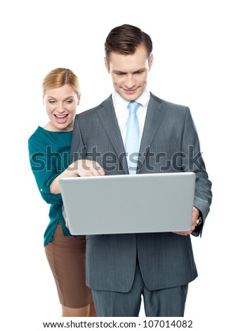 Smiling business people using laptop isolated against white background
