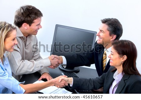 Smiling business people working in office - stock photo