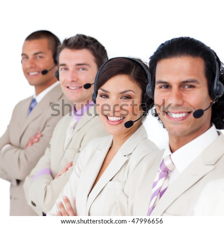 Smiling business team lining up with headset on against a white background - stock photo