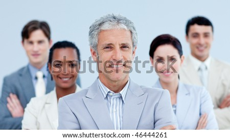 Smiling business team showing ethnic diversity against a white background - stock photo