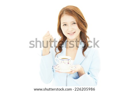 Smiling business woman drinking coffee.