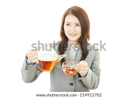 Smiling business woman drinking tea
