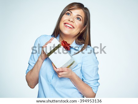 Smiling business woman hold gift box. White background isolated portrait of young model with long hair.