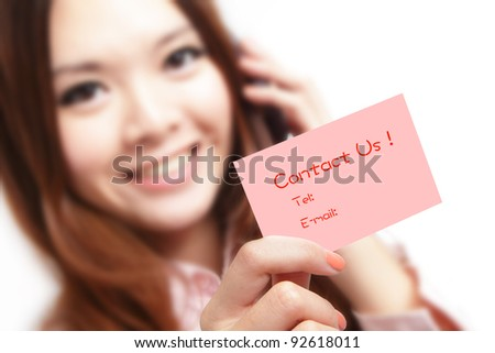 Smiling business woman holding a card (Contact Us) and speaking mobile phone! isolated on white background, model is a asian beauty