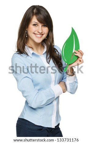 Smiling business woman holding eco leaf isolated on white background - stock photo