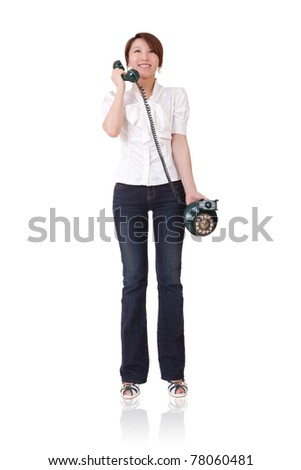 Smiling business woman holding telephone and talking, full length portrait isolated on white background. - stock photo