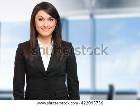 Smiling business woman in the office - stock photo