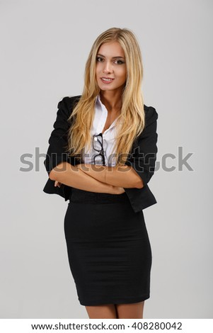 Smiling  business woman on gray background. crossed arms - stock photo