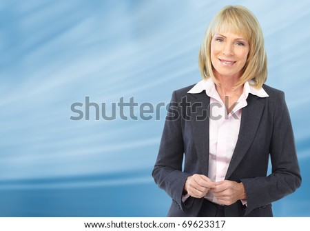 Smiling business woman. Over blue background - stock photo