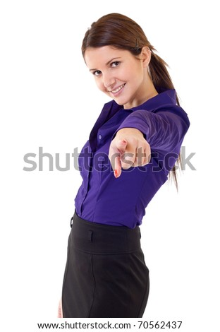 Smiling business woman pointing finger at you