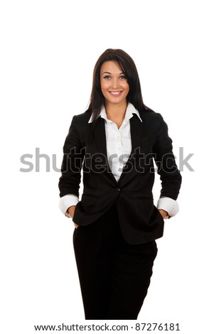 Smiling business woman standing with hand in pockets. Isolated over white background