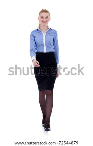 Smiling business woman walking. Isolated in white. - stock photo
