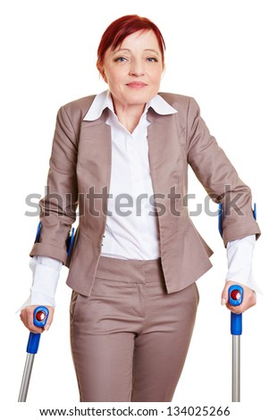 Smiling business woman walking with two crutches
