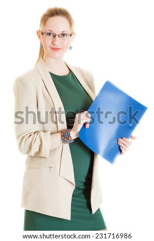 smiling business-woman wearing a green dress and jacket stands with folder - stock photo