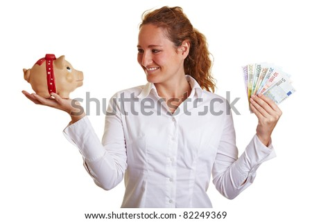 Smiling business woman with piggy bank and Euro money - stock photo