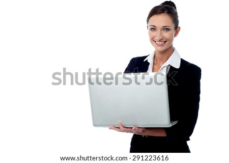 Smiling business woman working with laptop - stock photo