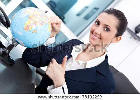 smiling business women discovery place for new investment, giving  thumb up - stock photo