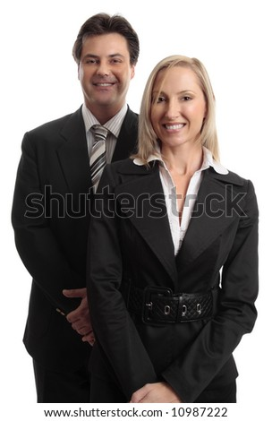 Smiling businessman and businesswoman standing together. - stock photo