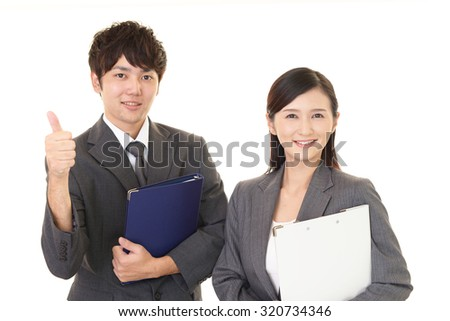 Smiling businessman and businesswomen